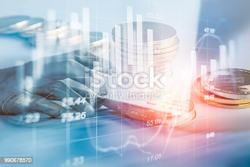 687520174istockphoto Business man on stock market financial trade indicator background. Man analysis stock market financial trade indices on LED. Double exposure of business man trade on stock market financial concept. 990678570