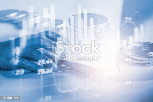 istock Business man on stock market financial trade indicator background. Man analysis stock market financial trade indices on LED. Double exposure of business man trade on stock market financial concept. 991591990