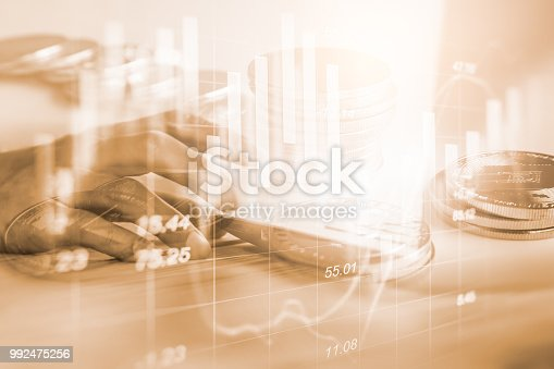 istock Business man on stock market financial trade indicator background. Man analysis stock market financial trade indices on LED. Double exposure of business man trade on stock market financial concept. 992475256