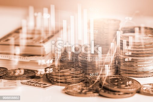687520174istockphoto Business man on stock market financial trade indicator background. Man analysis stock market financial trade indices on LED. Double exposure of business man trade on stock market financial concept. 998858852