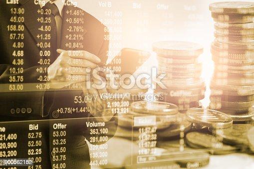 903982138istockphoto Business man on stock market financial trade indicator background. 900562182