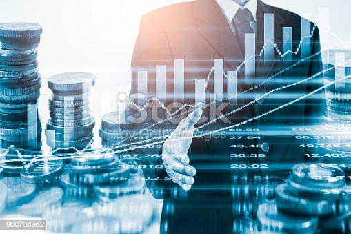 903982138istockphoto Business man on stock market financial trade indicator background. 900738652