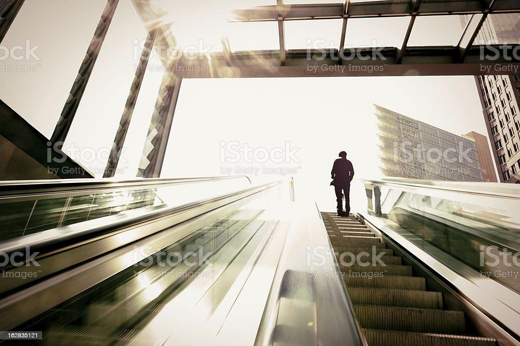 Business man on the escalator royalty-free stock photo