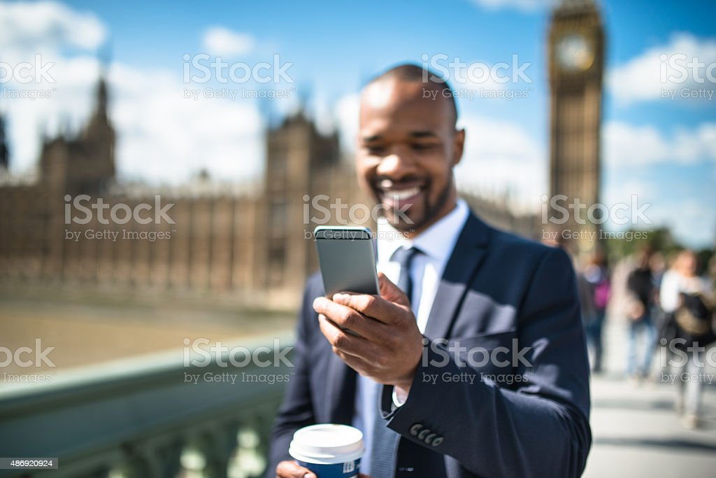Business man on the phone in london stock photo