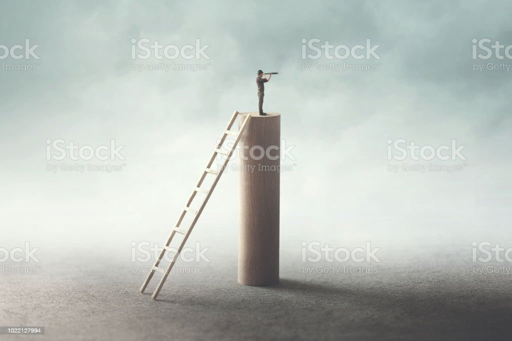 business man on the top watching the future with binocular stock photo