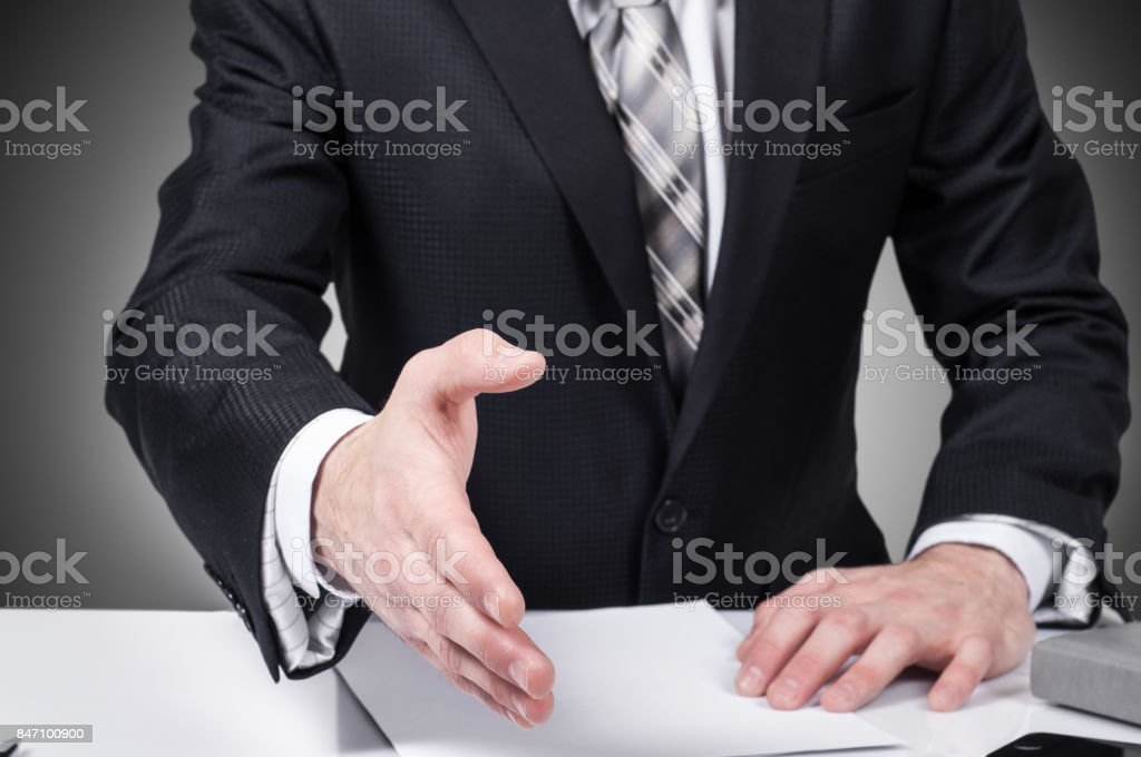 Business man open hand ready to seal a deal, partner shaking hands, in the office stock photo