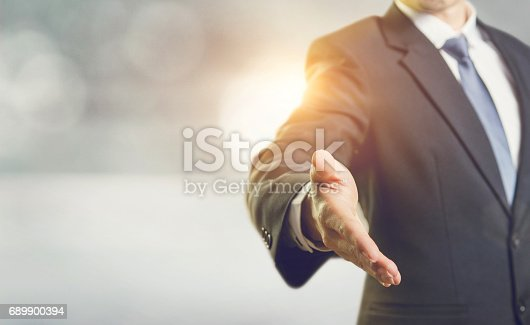 istock Business man open hand ready to seal a deal, Partnership business. 689900394