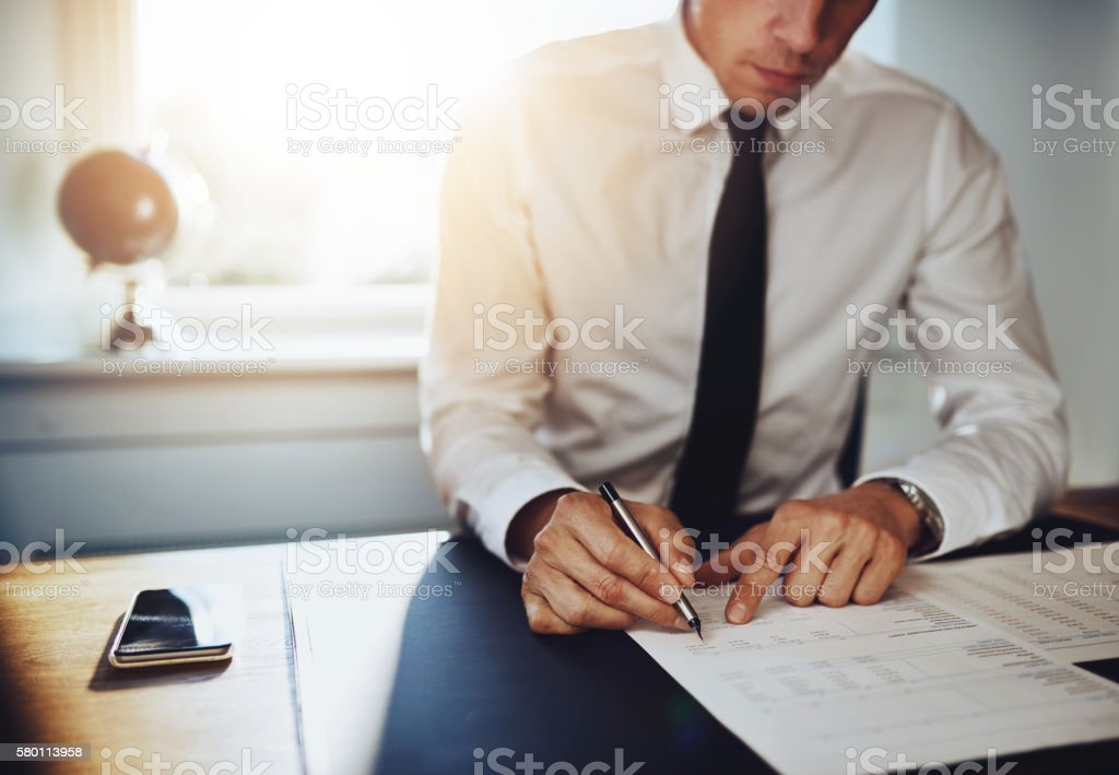 Business man or accountant lawyer working on documents stock photo