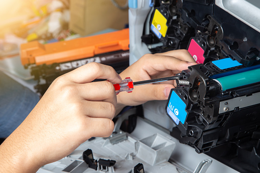 istock Business man or technician is checking and changing the printer equipment cartridges tone of laser jet multi function printer in the office. 1160996781