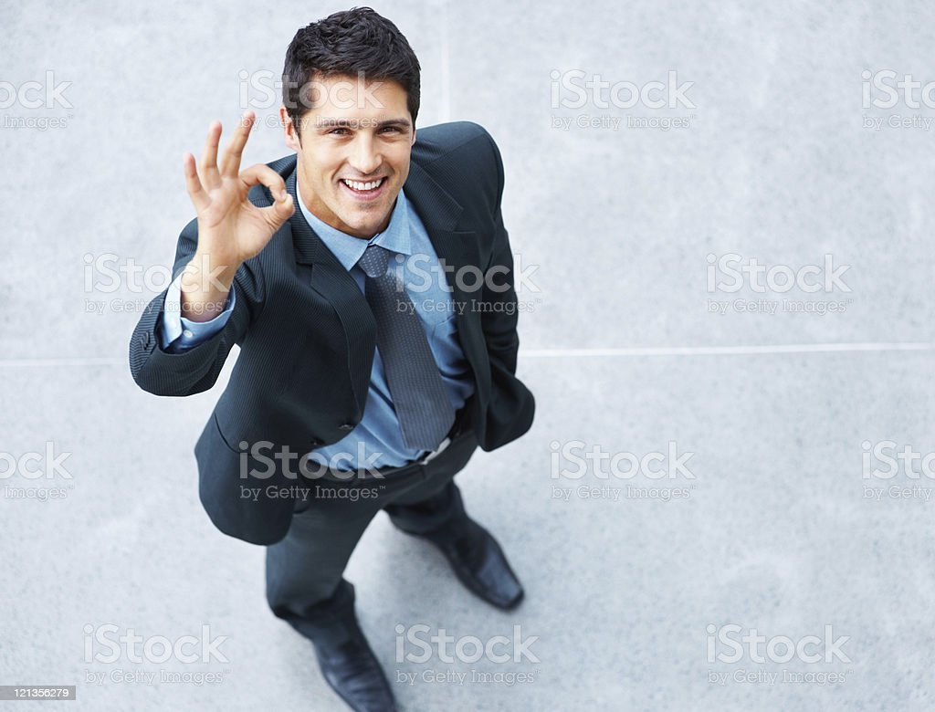Business man outdoors giving okay sign royalty-free stock photo