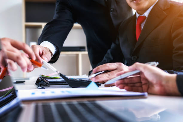 Business man people co-working for analyzing financial data investment in office.Teamwork successful meeting workplace strategy concept. stock photo