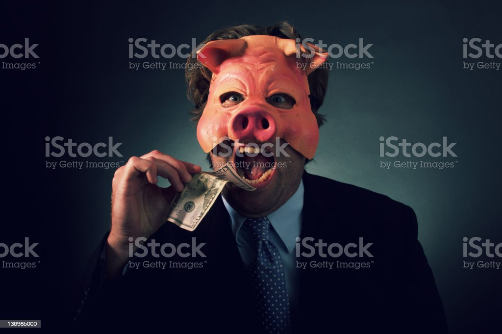 Business Man Pig Eating Money stock photo