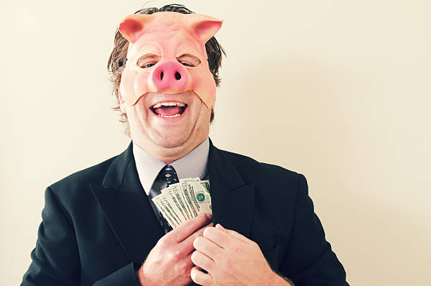 Business Man Pig Money a businessman with a pig mask on holding cash money. greed stock pictures, royalty-free photos & images