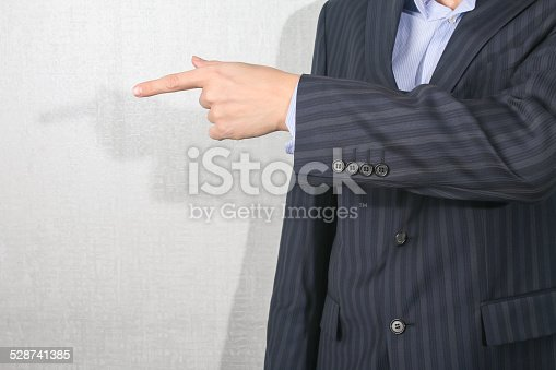 istock business man pointing  his finger 528741385