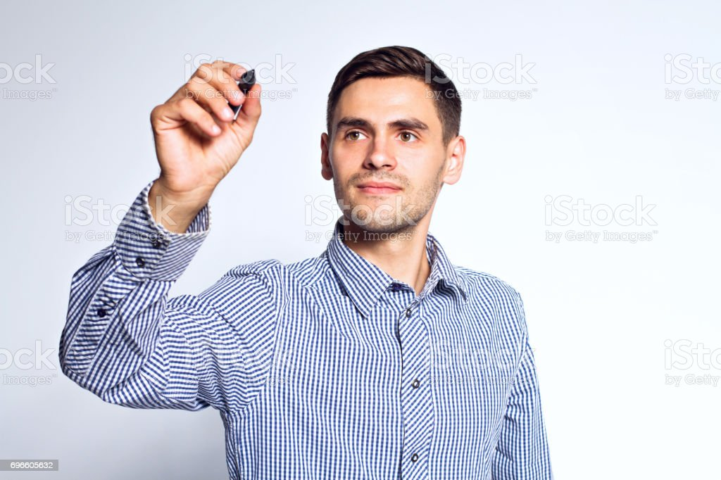 Business man pointing something with marker on white background stock photo