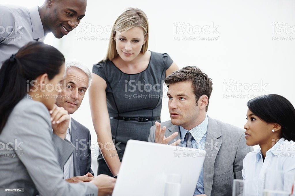 Business man presenting his idea on laptop to colleagues royalty-free stock photo