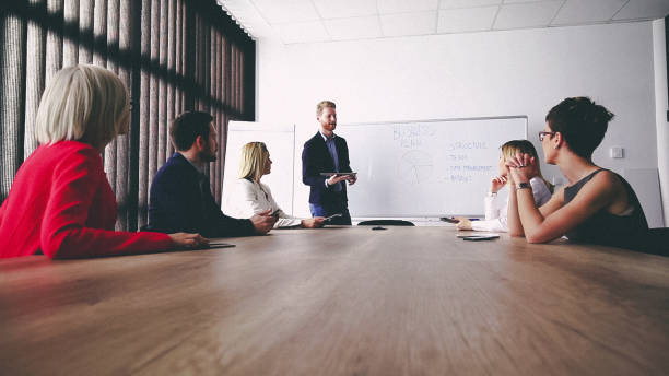 Business man presenting new ideas and projects to his team stock photo