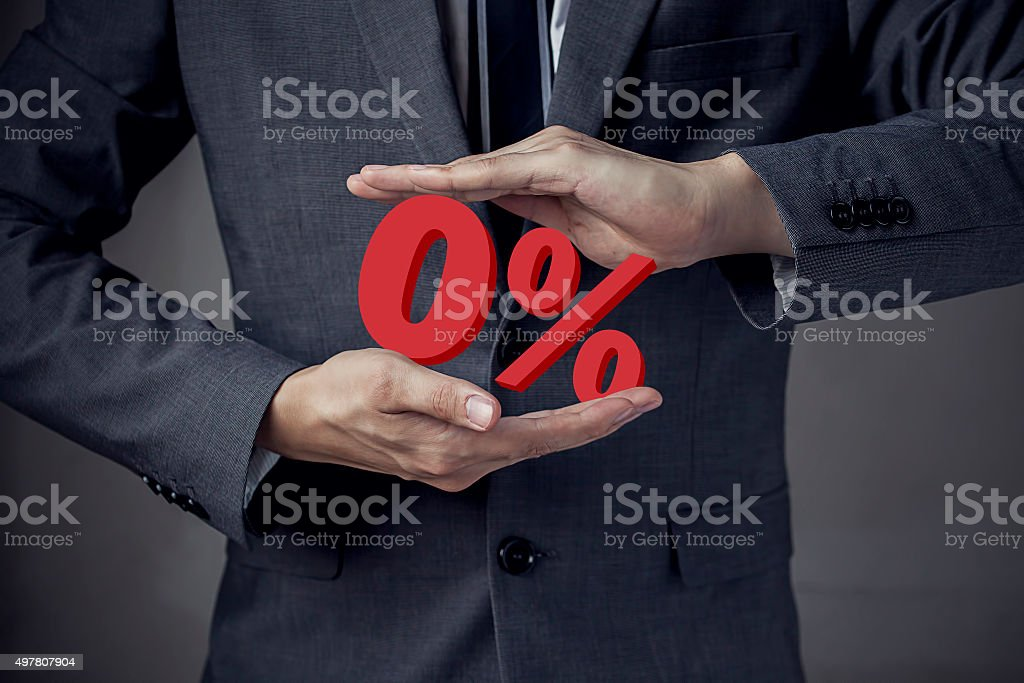 Business man Presenting Zero Percent, indicating zero interest a stock photo