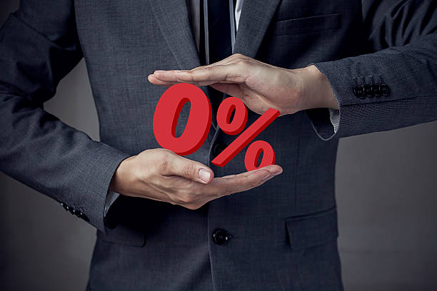 business man presenting zero percent, indicating zero interest a - interest rate stock photos and pictures