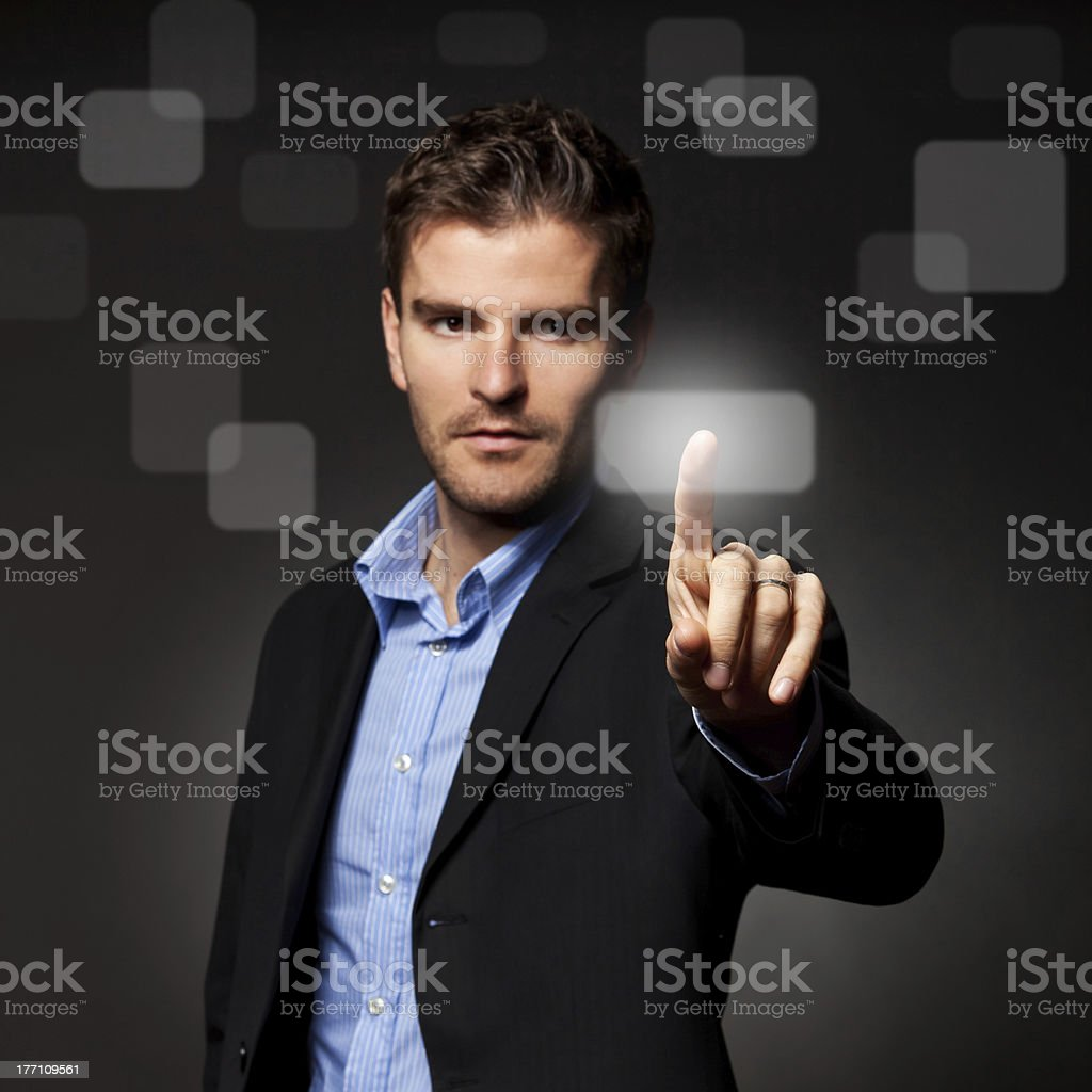 business man pressing a touchscreen button royalty-free stock photo