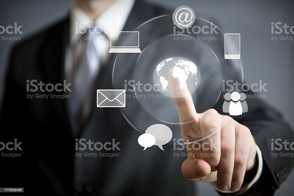 Business man pressing an icon in air Business man pressing an icon in air Adult Stock Photo