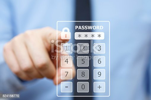 istock Business man pressing security code on virtual keypad 524158770
