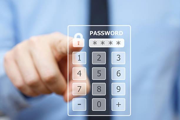 Business man pressing security code on virtual keypad stock photo