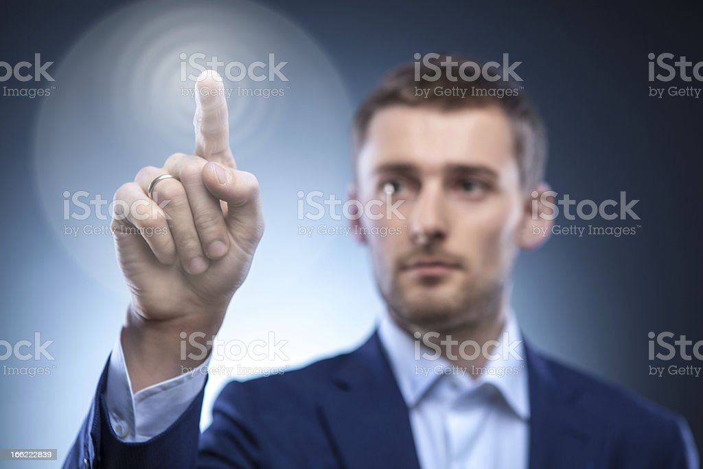 business man pressing touchscreen button royalty-free stock photo