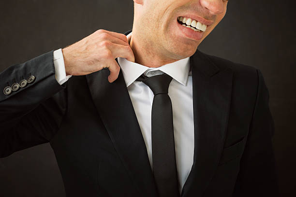 business man pulling his shirt of his neck - 衣領 個照片及圖片檔