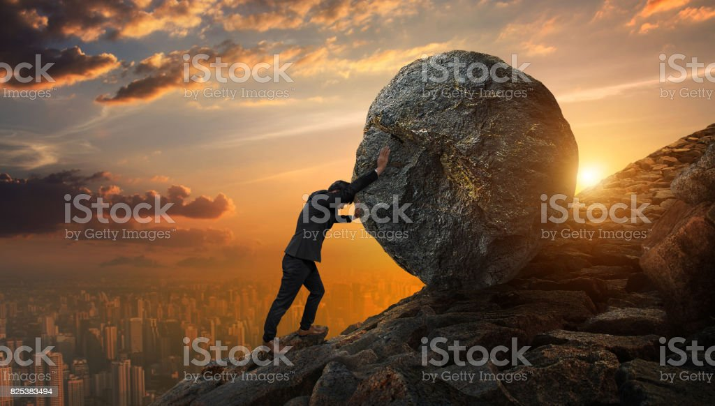 Business man pushing large stone up to hill , Business heavy tasks and problems concept. royalty-free stock photo