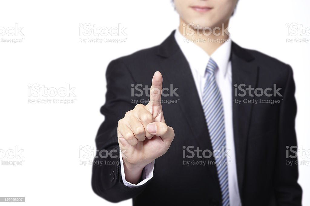 Business Man pushing on a touch screen interface royalty-free stock photo
