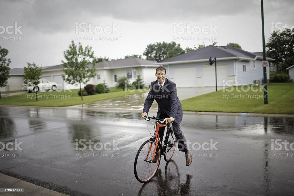 Business Man Rain Biker stock photo