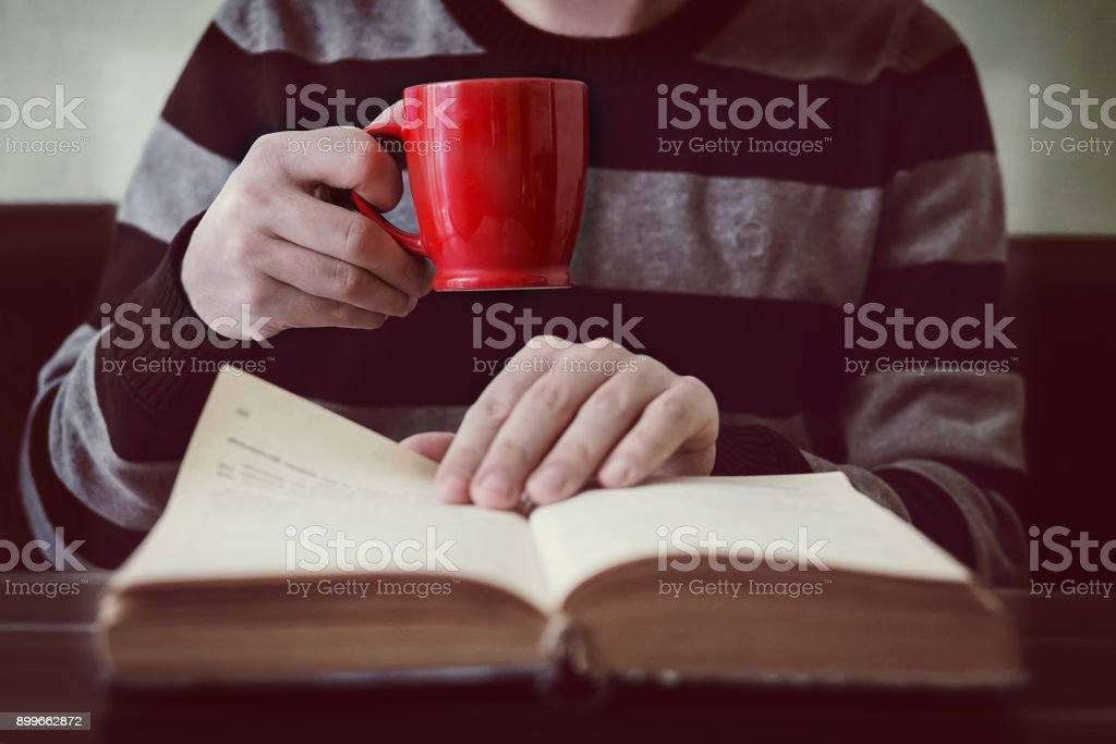 Business man reading book with coffee in coffee shop. stock photo