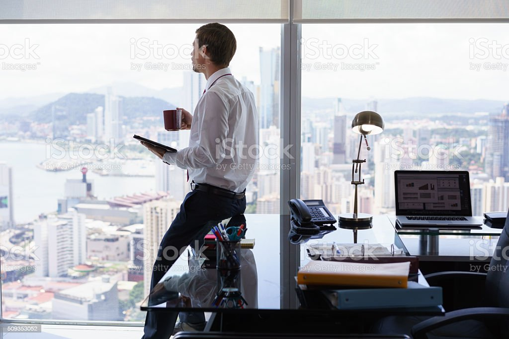 Business Man Reading News Press Review On Tablet PC stock photo