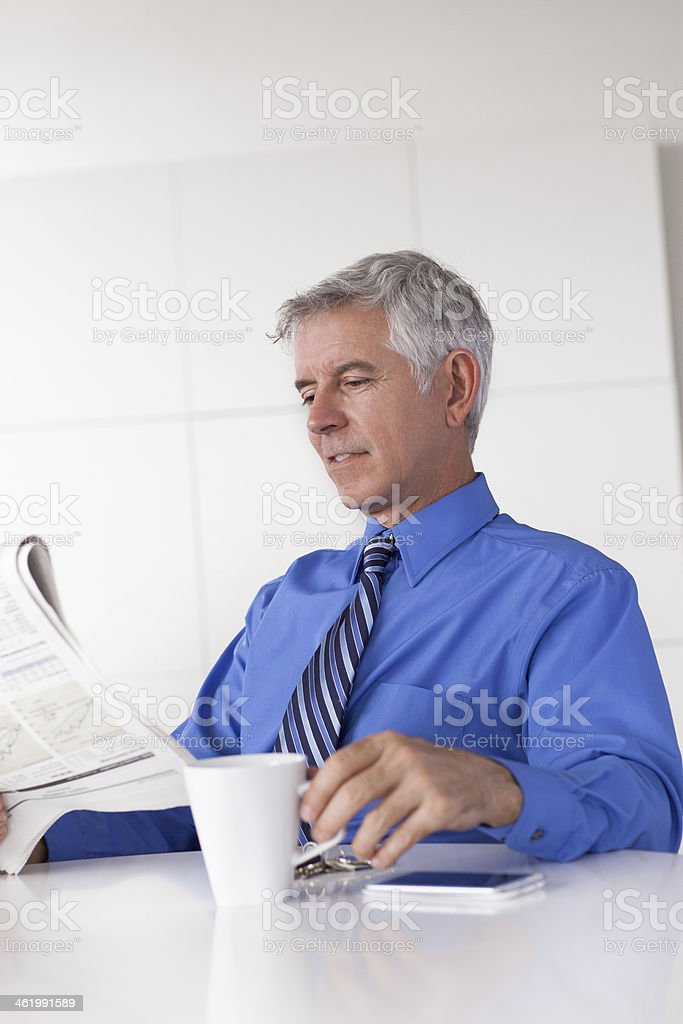 business man reading newspaper royalty-free stock photo