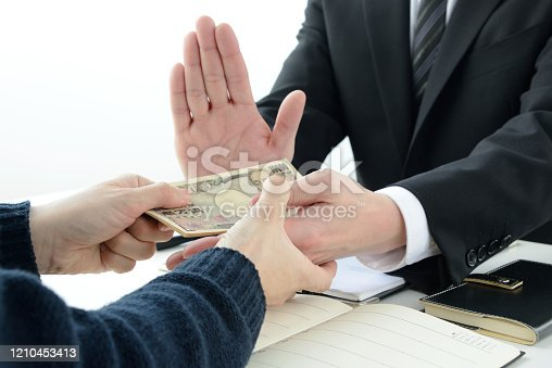 848170878 istock photo Business man refusing acceptance of bribe 1210453413