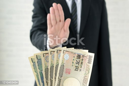 848170878 istock photo Business man refusing acceptance of bribe 1210453434