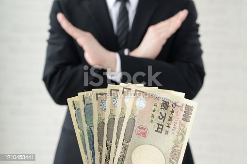 848170878 istock photo Business man refusing acceptance of bribe 1210453441