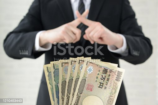 848170878 istock photo Business man refusing acceptance of bribe 1210453443
