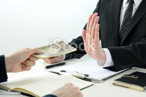 848170878 istock photo Business man refusing acceptance of bribe 1210453454