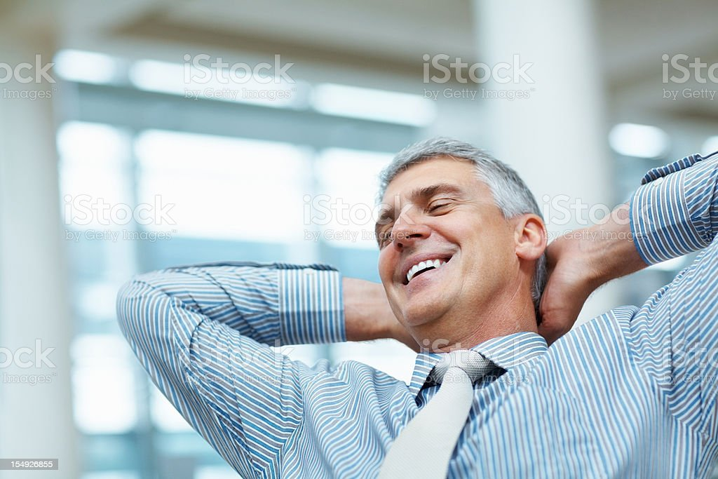 Business man relaxing in the office - Royalty-free Achievement Stock Photo