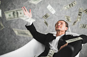 istock Business man, rich, millionaire, billionaire, with many banknote dollars money 1016186674
