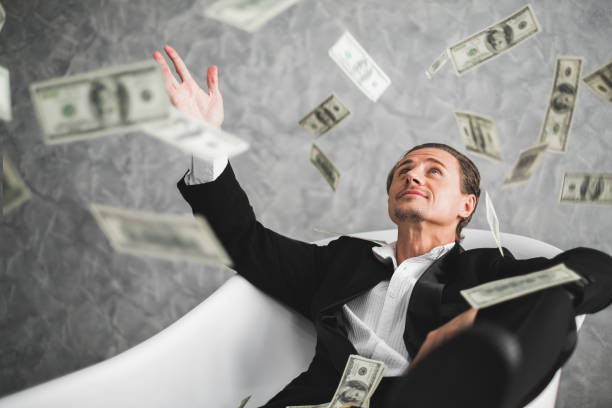 Business man, rich, millionaire, billionaire, with many banknote dollars money Business man, rich, millionaire, billionaire, with many banknote dollars money millionnaire stock pictures, royalty-free photos & images