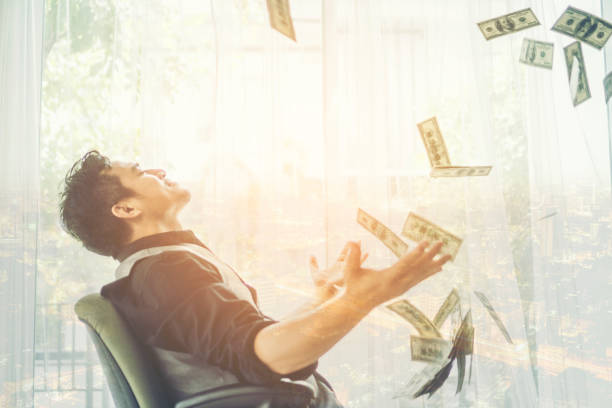 business man, rich, millionaire, billionaire, with many banknote dollars money - throw money away stock pictures, royalty-free photos & images
