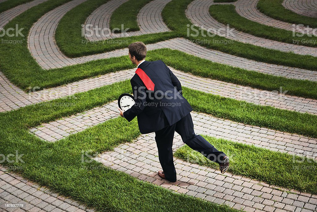 Business Man Running in Corporate Maze Against Time Deadline royalty-free stock photo
