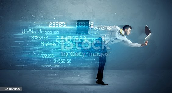 istock Business man running with device and data concept 1084529382