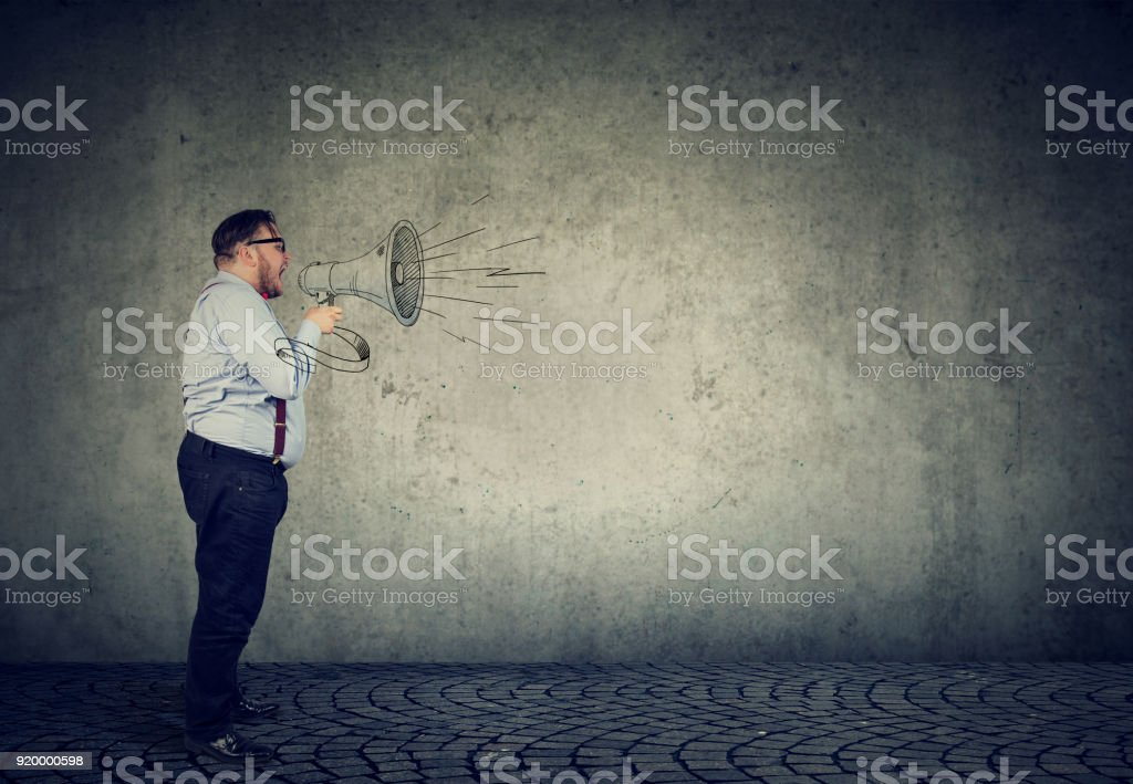 business man screaming in a megaphone making an announcement stock photo