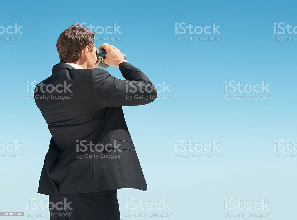 Business man searching for something with binoculars royalty-free stock photo