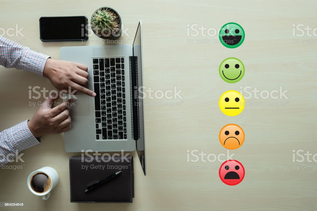 business man select happy on satisfaction evaluation? And good mood smiley - Royalty-free Advice Stock Photo