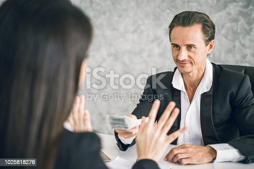 848170878istockphoto Business man sending money to business woman, corruption and anti corruption concept 1025818276
